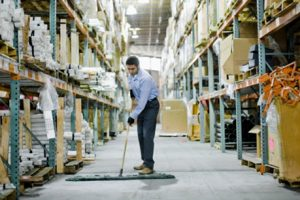 Warehouse Worker Sweeping